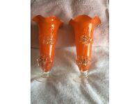 a pair of orange vases