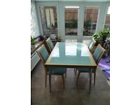 Stylish expandable kitchen or dining room table and 6 matching chairs