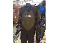 A selection of 6 wet suits, excellent condition