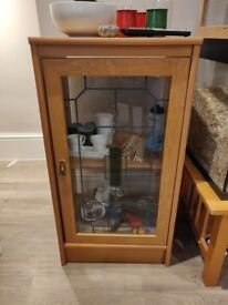 Small cabinet with stained glass effect door