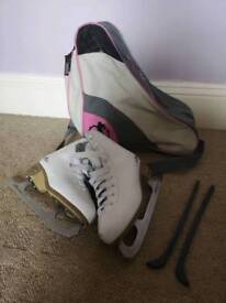 Girls ice skates and a bag