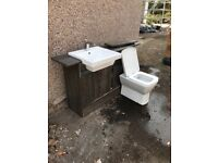 Bathroom furniture with sink and toilet