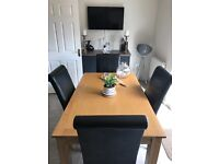 Solid oak dining table and 4 faux leather chairs