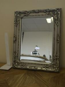 SMALL ANTIQUE SILVER WALL MIRROR WITH ORNATE FRAME OVERALL SIZE 21