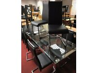 Glass table chrome legs with 6 Leather chairs with chrome legs