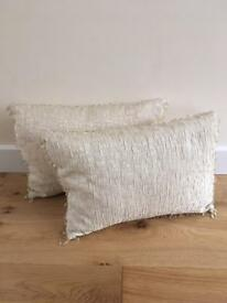 Gorgeous pair of cream Debenhams cushions with peardrop beading. Measures 40cms by 30cms.