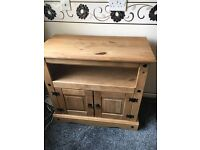 Television stand, wall unit and coffee table in oak. Will sell seperatly.