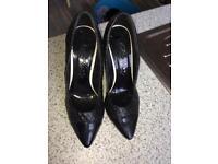 Black paten high heeled shoes