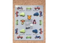 Child's bedroom magnet board vehicles by Next