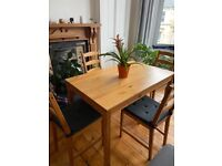 Wooden Dining Table and Chairs with cushions
