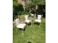 Wrought iron table & 3 Matching chairs