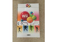 White Nintendo Wii, Wii fit board and a variety of games
