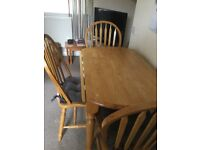 Table and 3 chairs 4 th damaged