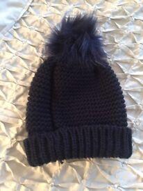 Woman's navy bobble hat