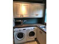 Cream utility room / small kitchen cabinets