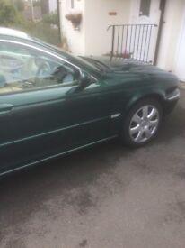 Beautiful racing green Jaguar for sale. New MOT . Low Mileage.