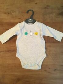 Mothercare long sleeved bodysuit. 0-1 month