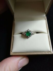 Emerald and diamond bespoke cluster ring