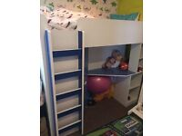 Bunk bed with wardrobe, table and shelves
