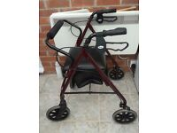 WALKING AID/ROLLATOR SOMETHING TO HELP YOU WITH YOUR WALKING AND GIVE YOU A SEAT WHEN YOU NEED IT