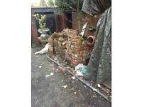 Reclaimed brick. Three piles of bricks