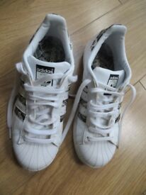 Adidas Superstar trainers size 7 in white.
