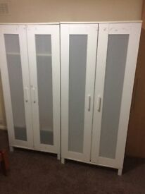 2 matching white cupboards