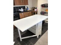 White collapsible dining table with 6 draws and 4 chairs