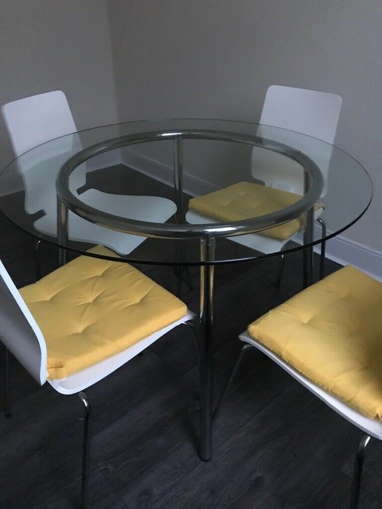 Ikea round glass table with four white chairs | in ...