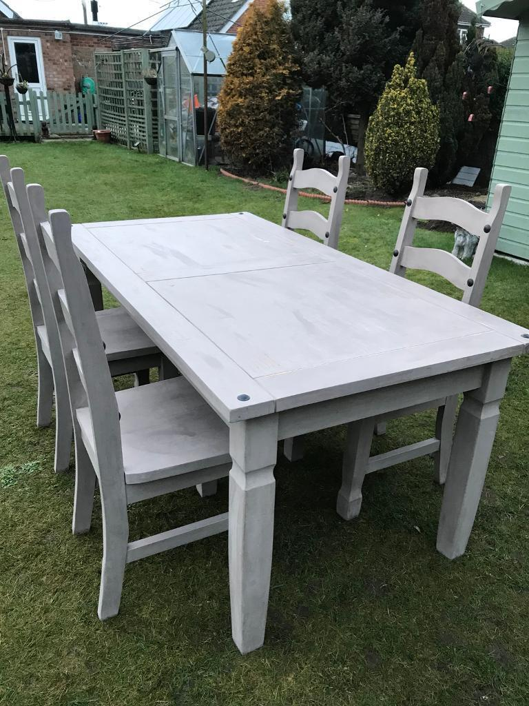 Solid pine painted dining table with four chairs ( can deliver )