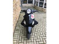 Vespa lx 125 reg as 50! + leg cover