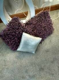 Two plum cushions one sm silver in new condition