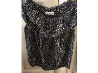 Women's Top. Size 10-12 Polyester .Black and white in colours