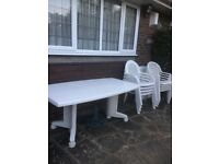 White Plastic Outdoor Table and Chairs