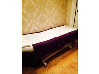 White hydrolic lift beauty bed