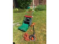 Lawn mower, strimmer and spreader