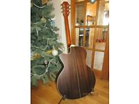 Aria ASP Sandpiper 100-CE N solid Cedar top acoustic guitar. Built in tuner and rigid case