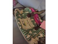 Yummy mummy changing bag with bright pink lining in good condition from a pet and smoke free home.