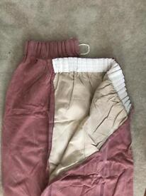 Dusty pink pair of velvet curtains