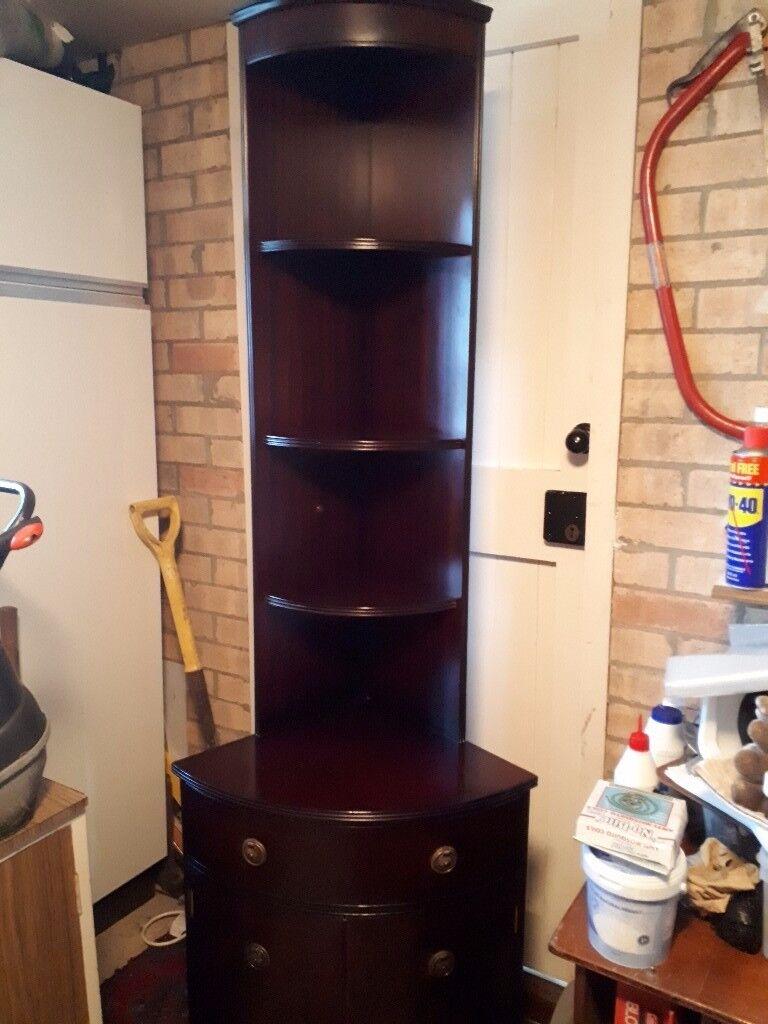 Solid dark wood corner unit.