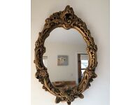 Vintage Rococo oval mirror with ornate gilt frame