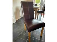 Dining room chairs, very good condition. Set of 4 wooden frame, faux leather finish.