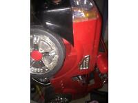 Red 12v kids car with remote