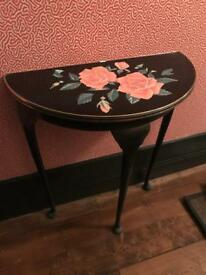 Vintage console table with rose design