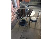 Lovely black glass dining table with 4 chairs