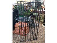 Heavy wrought iron garden gate