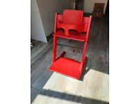 Red Stokke Tripp Trapp chair with baby set