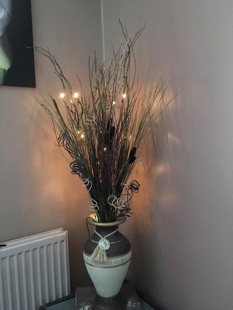 Flowers with lights and vase