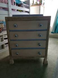 Wooden four drawer chest with engraved flower detail