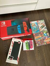 Nintendo Switch console, games, extra controllers case etc.